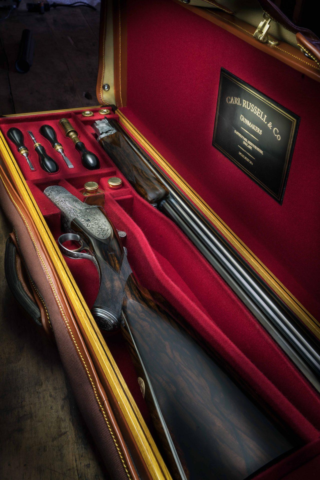 Shotgun in oak and leather case