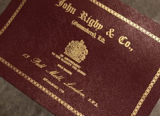 John Rigby & Co maroon leather case label