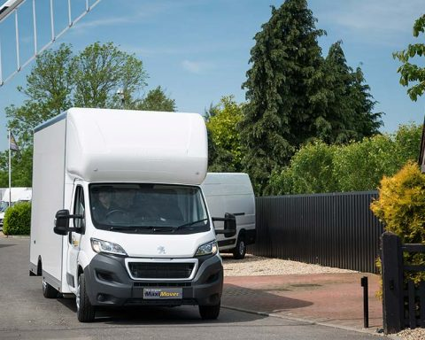 van-driving-through-barrier
